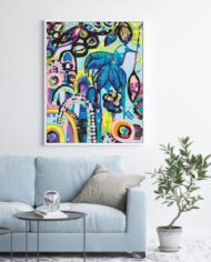 Tijuana-Hummingbird–light-blue-couch-white-portrait-frame-on-white-wall